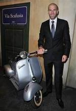 Sporting the Vespa with a Suit and Tie